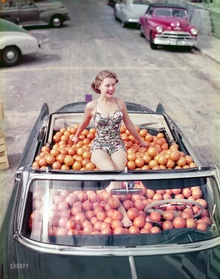 Oranges anyone? Note how the colors were effected by windshield tint. Circa 1952 swimsuit model ...