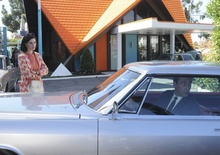Scene from Mad Men with Cadillac. Vintage Howard Johnson's restaurant in background.