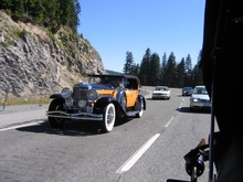 A Duesenberg J Derham Tourster cruising down the road.