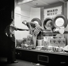 "October 1941. ""Dressing window in Amsterdam, New York."" The art of auto parts and accessories. ..."