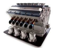THE MOST BEAUTIFUL ESPRESSO MACHINE IN THE WORLD. A TRIBUTE TO THE GRAND PRIX ENGINES ...