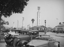 Early LA. with 1934 Ford roadster in foreground.