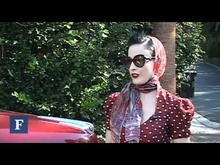 Pinup model Dita Von Teese shows off her vintage Packard and Ford convertible on a ...