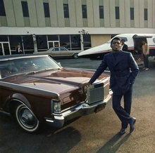 James Brown and his 1969 Lincoln Continental Mark III Coupe in front of his personal ...