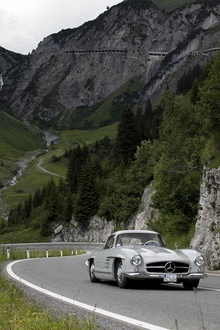 Open road in a Mercedes Gullwing.