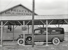 "January 1939. ""Funeral ambulance parked under gin shed. Mound Bayou, Mississippi."" Photo by Russell Lee, ..."