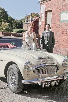 Like the old days in LA. Wedding couple with Austin Healey.