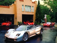McLaren and Ferrari grace this high end man cave.