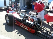 Legendary twin engined gas dragster the Freight Train fires up in the pits. While it ...