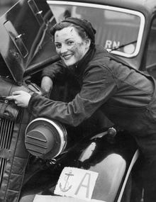 WWII era lady mechanic.