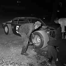 Henry Horenstein, Changing a Tire Between Races, Thompson Speedway, Thompson, CT, 1972 Gelatin Silver Print