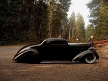 Radically chopped and lowered coupe, looks like Packard.