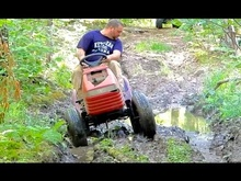 These dudes built a lifted mudding lawn mower! Seems like it needs a little more ...