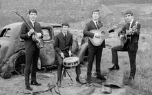 Very early Beatles promo shot. What's the car?
