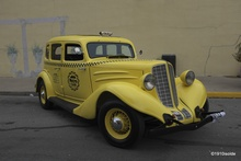 A 1934 Auburn Taxi Cab. Parked in downtown Auburn, Indiana during the 2013 ACD Festival. ...