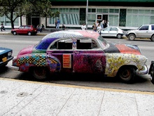 Havana, Cuba May 2002. Several cars painted by Cuban artists are on the streets of ...