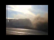 Locomotive obliterates truck stuck on RR tracks.