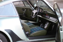77-930 interior. Green leather with Tartan insert seats. Magnus Walker.