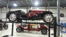 Type 55 Bugatti on lift with Hispano Suiza in the background. Stack 'em like cord ...