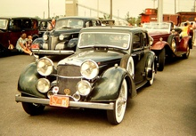 Early 1970s Canadian car show. At the front Alvis Speed 25 Vanden Plas saloon. I ...