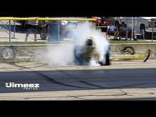 While reversing out of pre stage, this dragster goes out of control. Looks like the ...