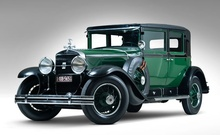 Al Capone's 1928 Cadillac V-8 Town Sedan sold at auction for $341K in July 2012.