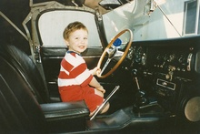 In 1983 I purchased this 1966 Jaguar XK-E Roadster and here's our little tike Andy ...