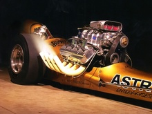 Early dragster makes flames in prestage. I love the smell of nitro in the evening!