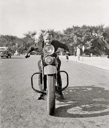 "September 15, 1937. ""First of fair sex to obtain motorcycle license in Capital. Although she ..."