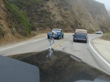 Highway 1, behind a 1934 Cadillac V-16 convertible sedan, with a Lagonda approaching and an ...