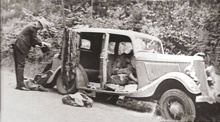 Photograph moments after Bonnie & Clyde met their end. 1934 Ford Tudor.