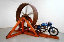 """The Big Wheel"" (1979) is a smallish, 250cc motorcycle with its rear wheel lifted off ..."